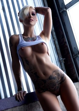 Short Haired, Fit And Tattooed