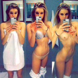 Undressing.